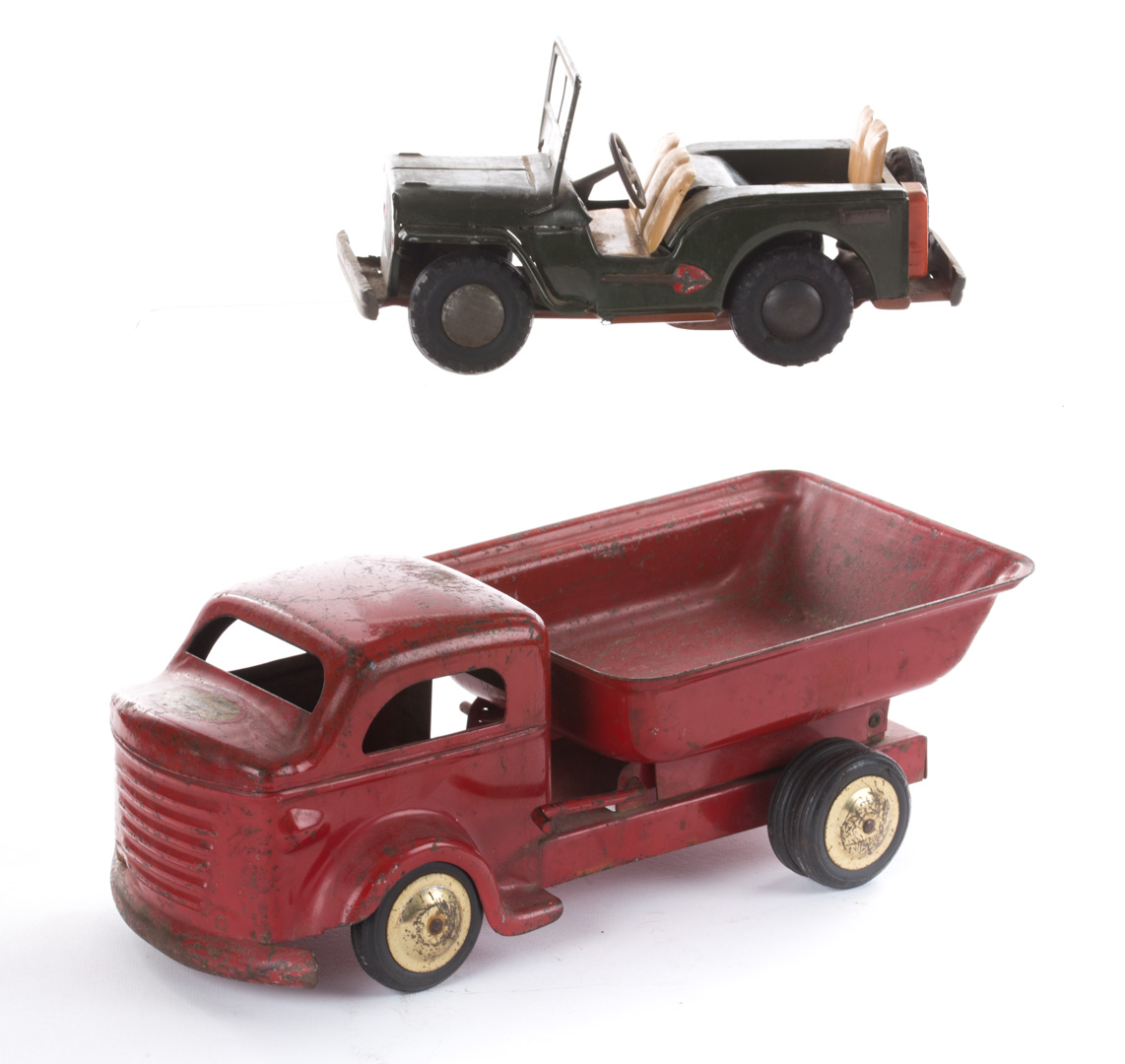 Pressed steel dump truck & friction tin jeep 1950s;