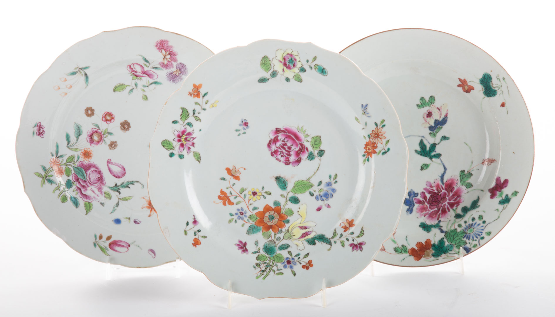 Three Chinese Export Famille Rose plates mid-18th