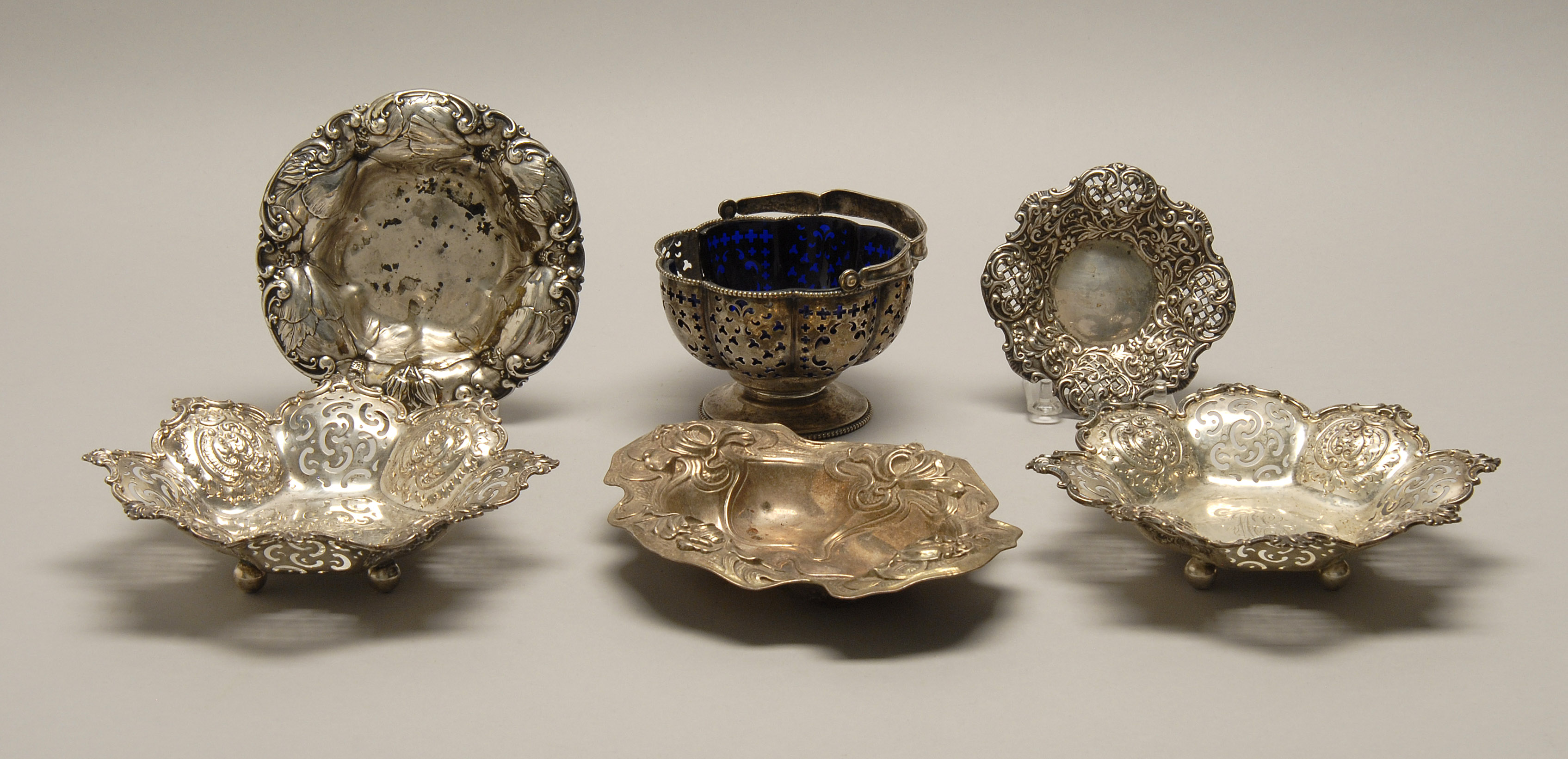 FIVE STERLING SILVER CANDY DISHES AND A CANDY