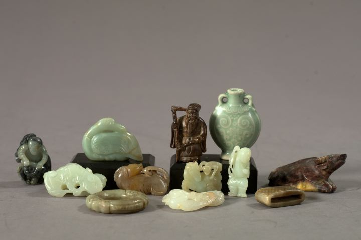 Collection of Twelve Carved Miniatures,