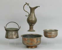 297. Four Persian Metal Containers  A lot