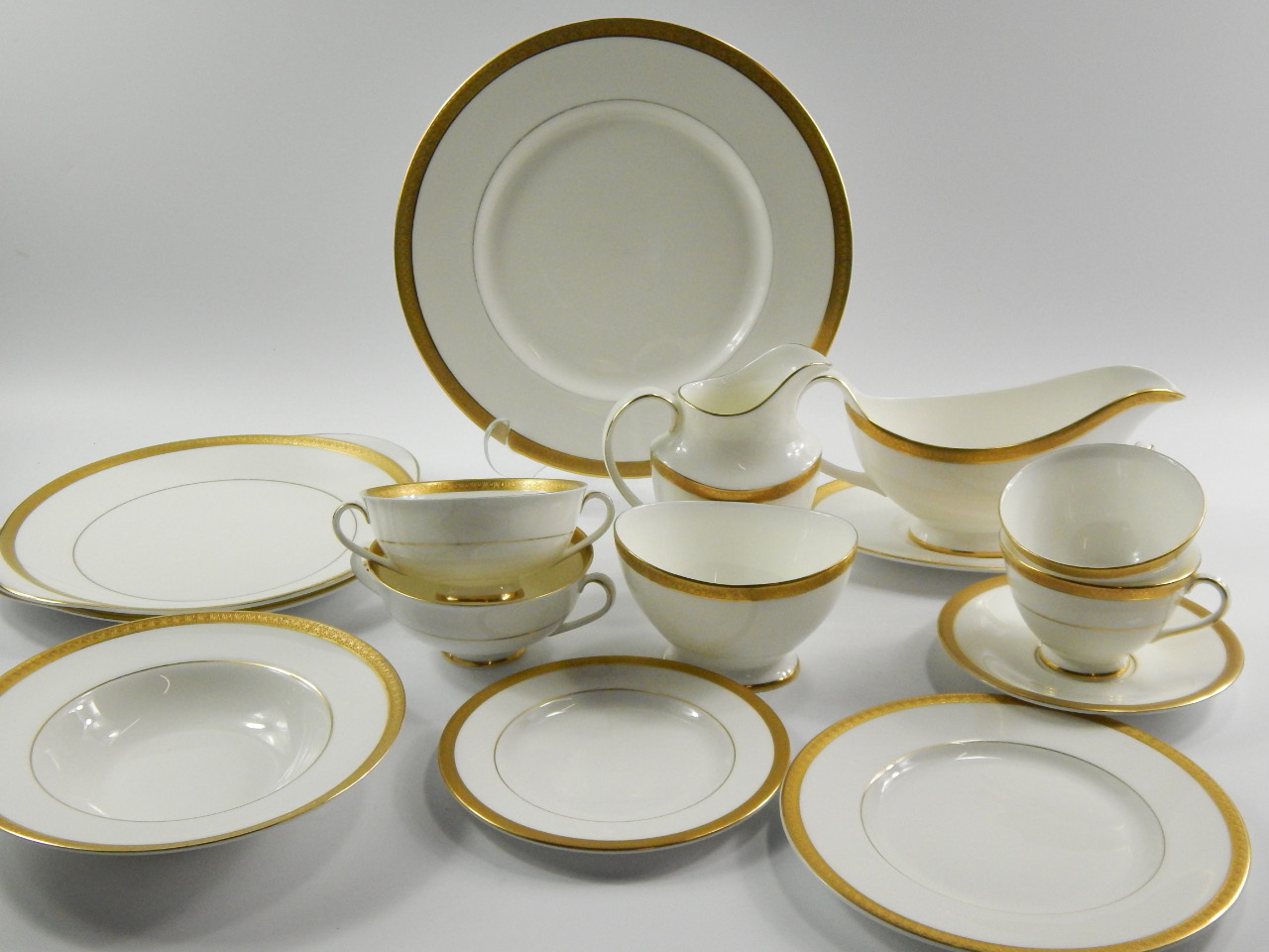 A Royal Doulton porcelain part dinner and