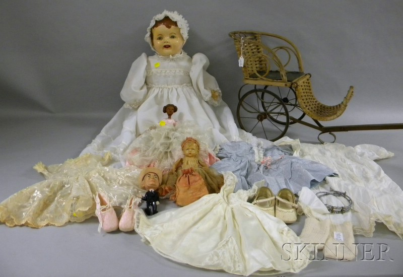 Group of Dolls and Dolls Clothing, a large