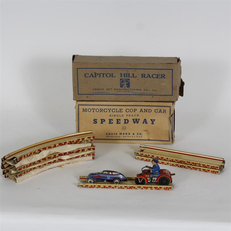 Group of tin windup toys with track Includes