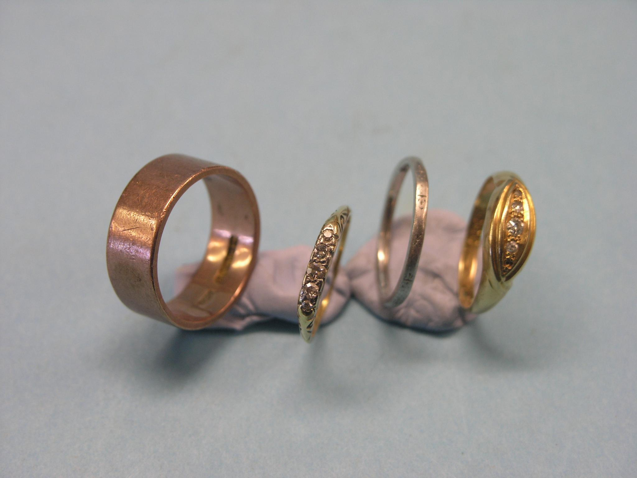 Two 18ct. gold and damond half-hoop rings,