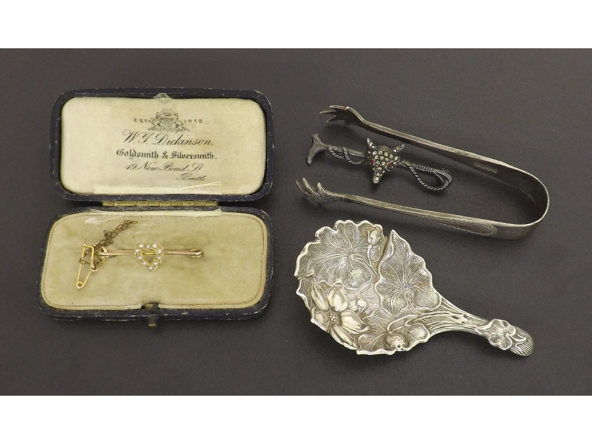 Victorian silver caddy spoon with embossed