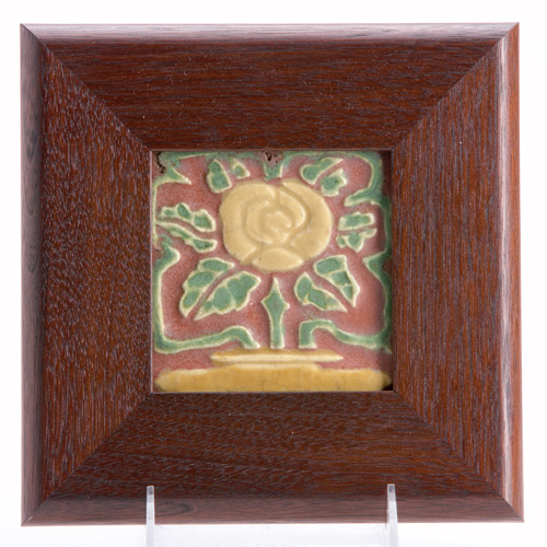 ROOKWOOD Faience tile embossed with a stylized