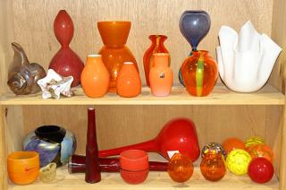 Two shelves of art glass vases and objects,