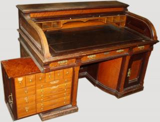 Wooton type roll top desk labeled D.S. Rickaby