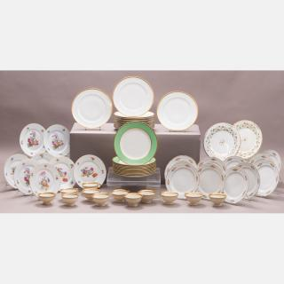 A Set of Twelve Limoges Dinner Plates with