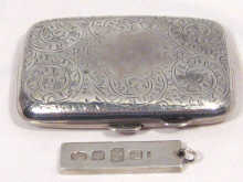 An engraved silver cigarette case , together