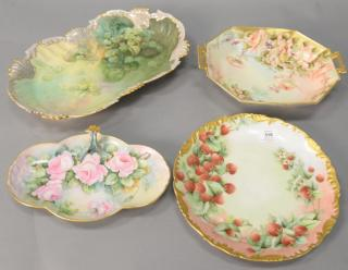 Four hand painted Limoges trays with flowers
