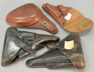 Group of four holsters including two German