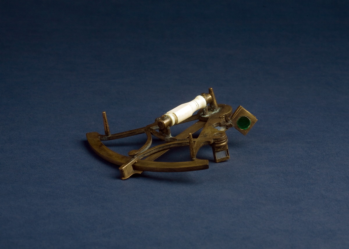 MINIATURE BRASS, STEEL AND IVORY SEXTANT.