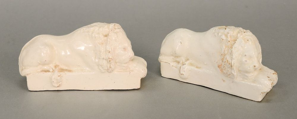 Pair of Staffordshire recumbent lion statues,