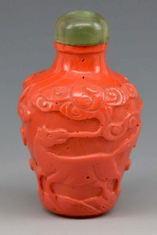 Chinese coral snuff bottle with carved horse: