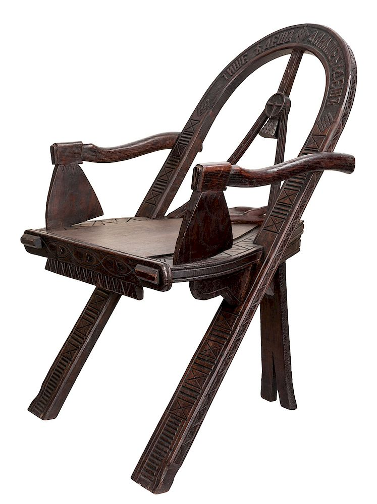 A RUSSIAN CARVED OAK CHAIR AFTER THE DESIGN