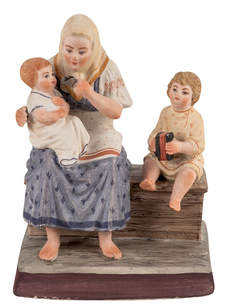 A RUSSIAN PORCELAIN FIGURE OF A PEASANT WOMAN