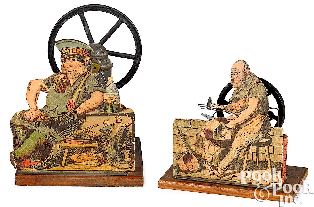 Two paper lithograph on wood steam toy accessories: