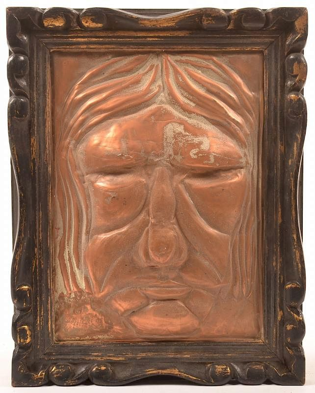 Embossed Copper Plaque Mask of a Man's Face.