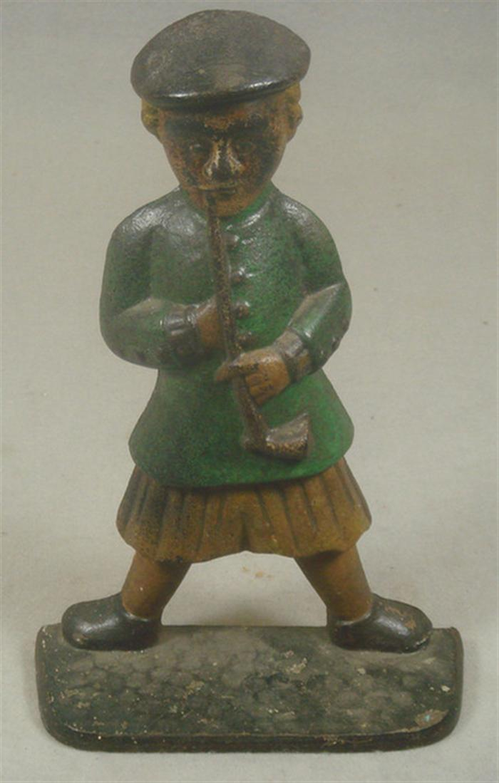 Cast iron doorstop, large man in quilt with