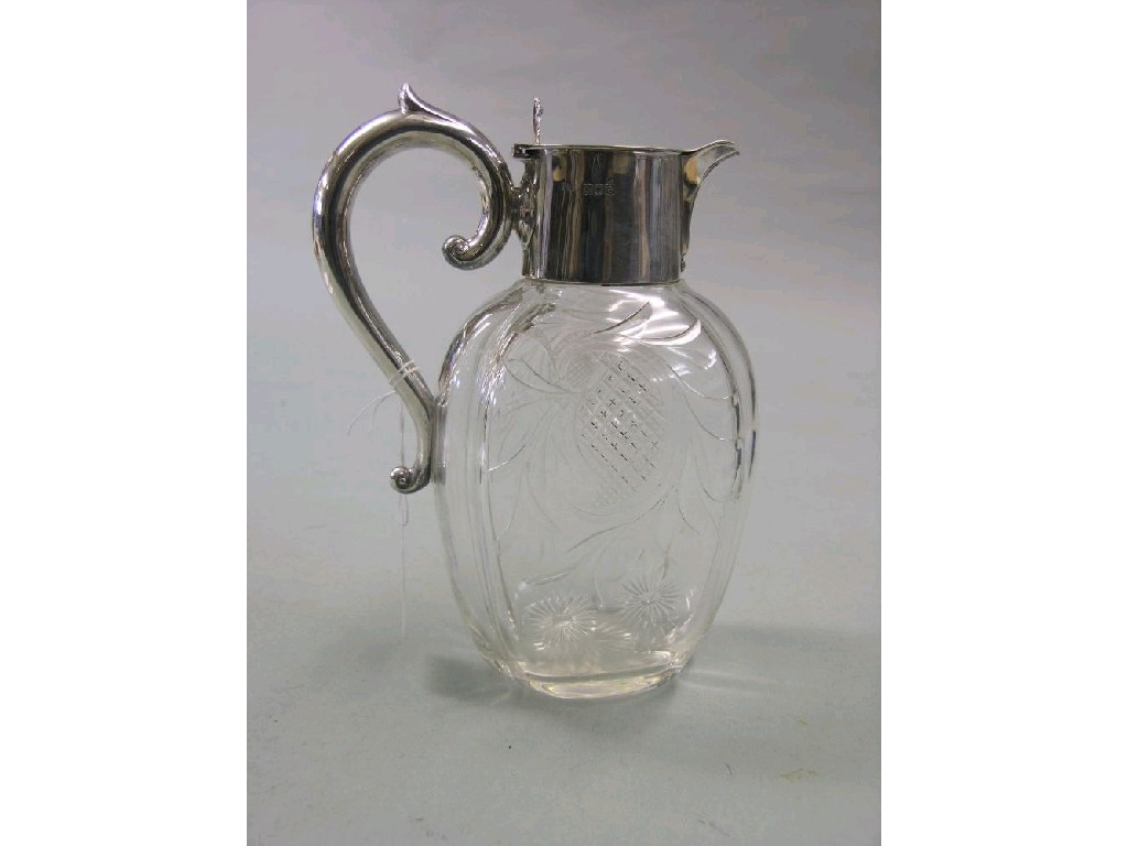 A late Victorian silver mounted glass claret