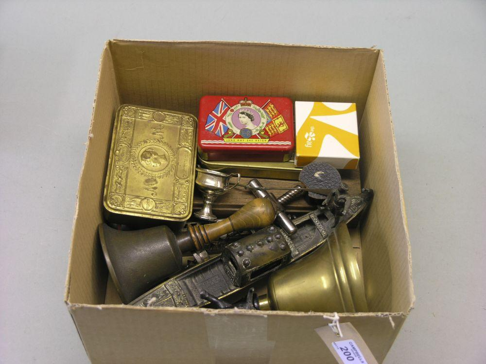 Two brass handbells, brass cigarette case,