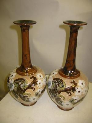 A PAIR OF ROYAL DOULTON POTTERY VASES of