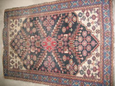 AN ANTIQUE NORTH WEST PERSIAN RUG, the ivory