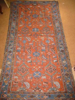 A NORTH WEST PERSIAN RUG, early 20th century,the