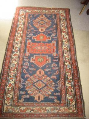 A NORTH WEST PERSIAN RUG, early 20th century,