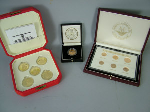 A cased collection of five 22ct gold commemorative