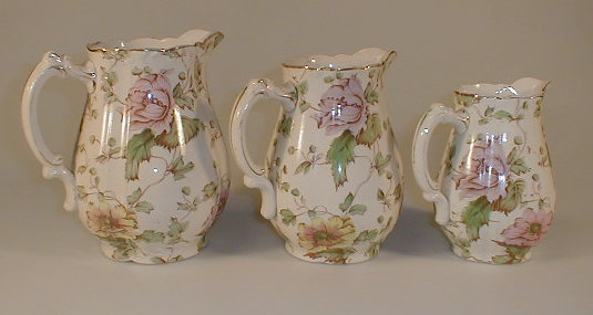 A set of three Staffordshire pottery baluster