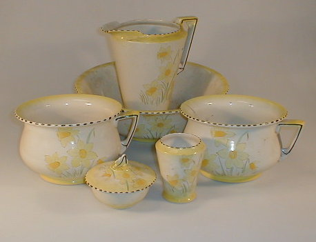 A Burleigh ware pottery toilet set, painted