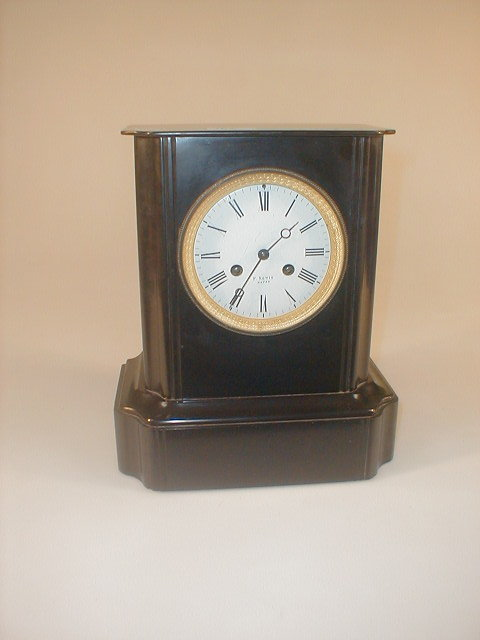 A 19thC French black slate mantle clock,