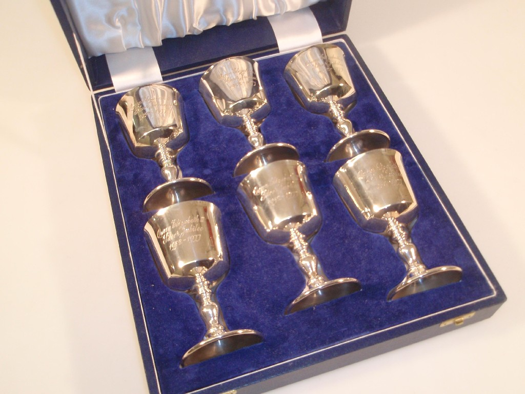 A set of six silver wine goblets, commemorating