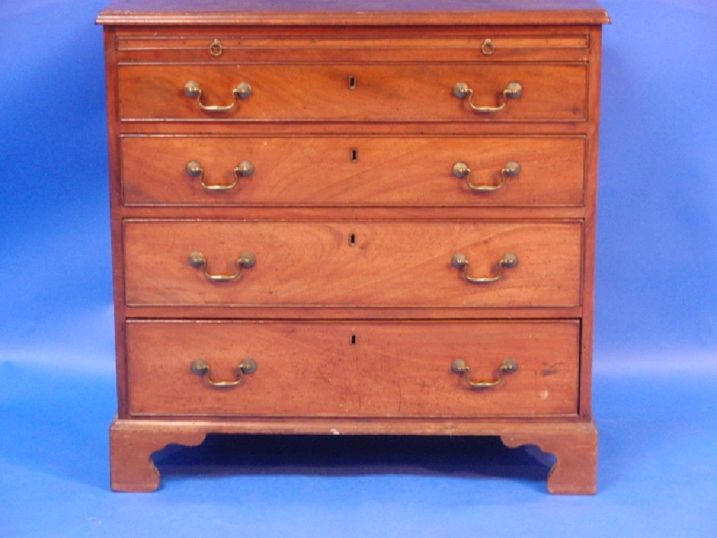 A George III flamed mahogany bachelors chest,