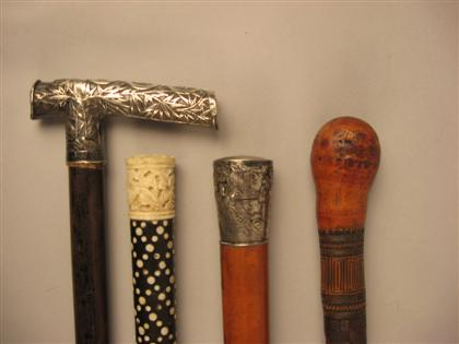 Group of four Asian walking sticks    19th/