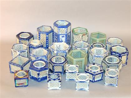 Twenty-five Japanese reticulated porcelain