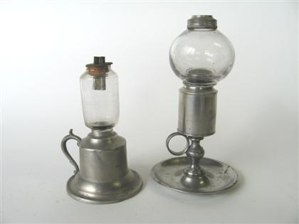Two pewter chamber lamps and two glass peg