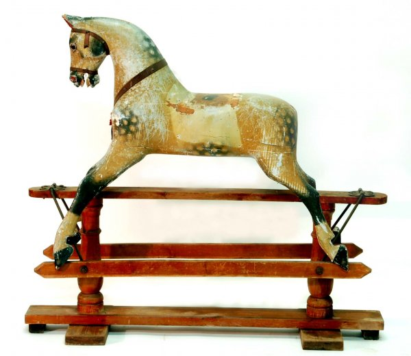 Large Victorian rocking horse of carved and