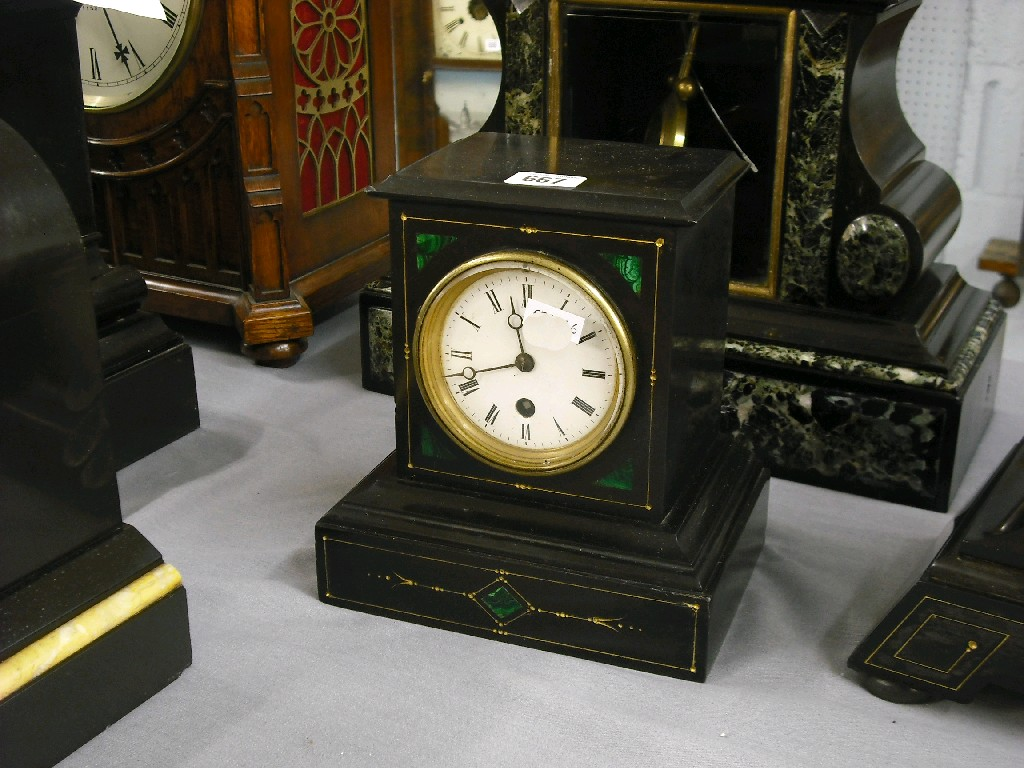 Small black slate and malachite mantel timepiece,