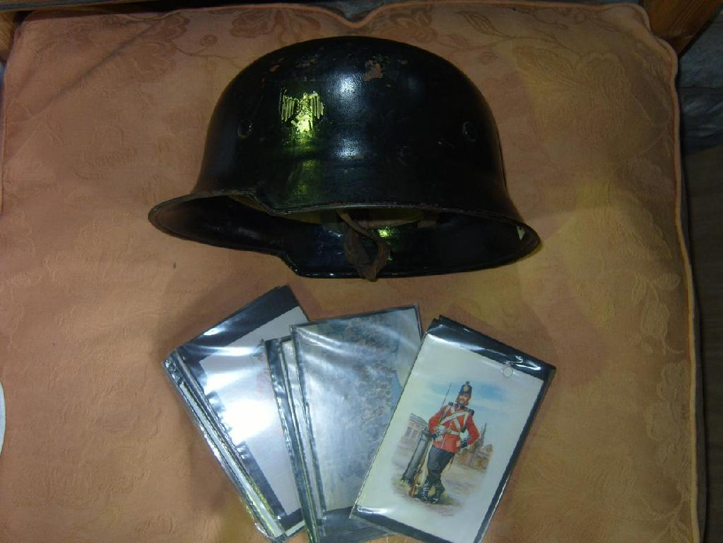 Price guide for A WWII German helmet and a number of military