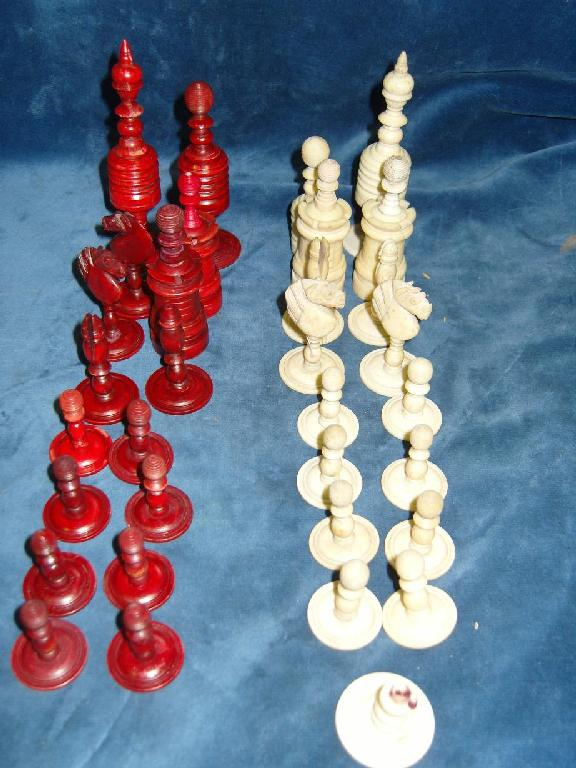A set of chessmen with stained red and white