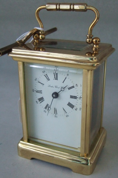 A gilt brass cased carriage clock, the white
