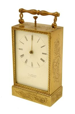 A continental gilt brass desk clock, with
