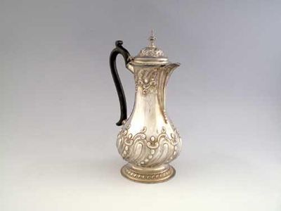 A late Victorian hot water jug, of baluster